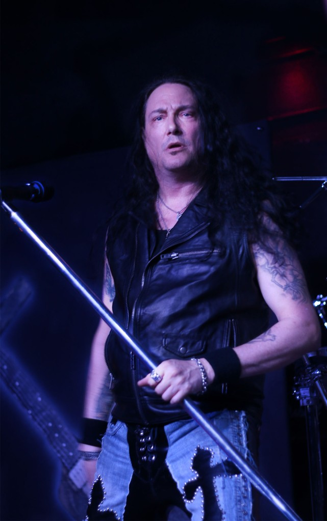 02182014 - Metal Church singer Ronny Munroe (cq), 48, interacts with the crowd during the band's show in Tempe, Ariz. Tuesday night.  Photo by Alec Damiano / JMC 351