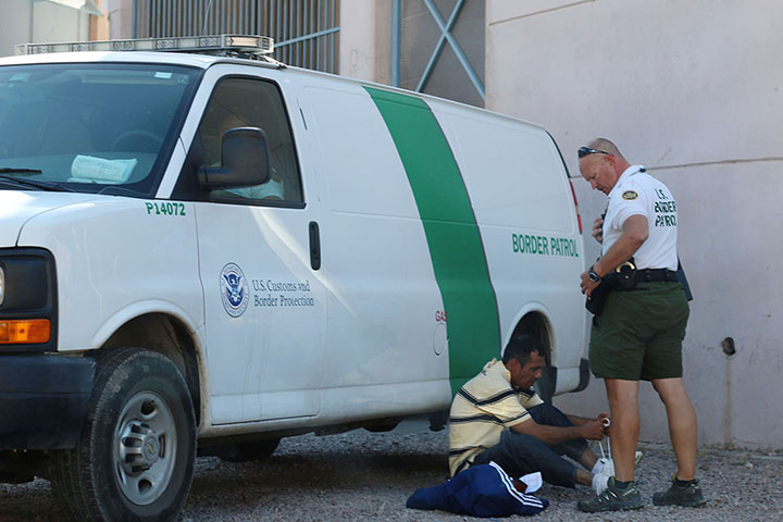 03082014 - A man ties his shoes while being detained by Border Patrol at the Morley Port of Entry in Nogales, Ariz.  Photo by Alec Damiano / JMC 351