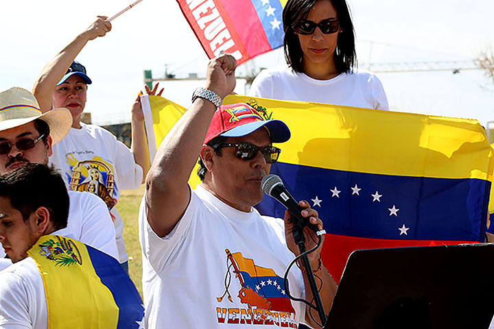 "02222014 - Rigo Duran (cq), 59, of San Cristobal, Venezuela, yells ""Viva Venezuela!"" before initiating a moment of silence in remembrance of those who died in the Venezuelan protests. A rally was held at the Tempe Beach Park Saturday to raise awareness. Photo by Alec Damiano / JMC 351"