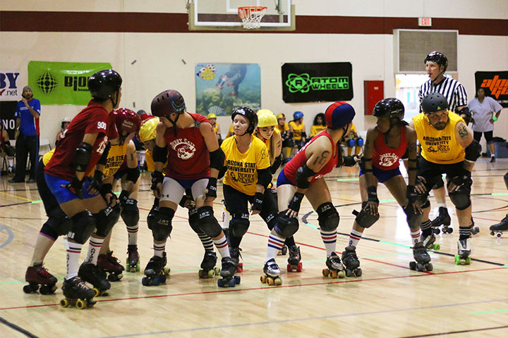 03222014 - The ASU Derby Devils and UA Derby Cats prepare to compete in a new round during a match in Mesa, Ariz. ASU beat the Derby Cats, 261-102.  Photo by Alec Damiano / JMC 351